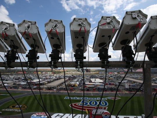 A cluster of mounted cameras monitors the front stretch at Charlotte Motor Speedway.