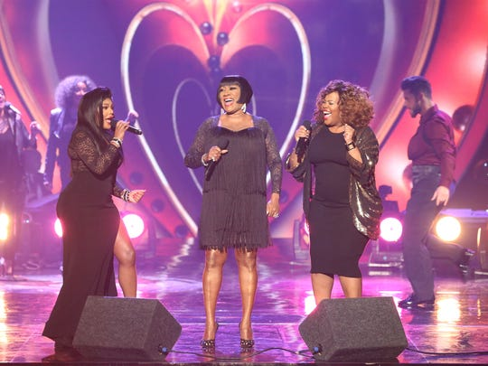 Patti LaBelle, center,  is backed up by Lil' Kim, left,