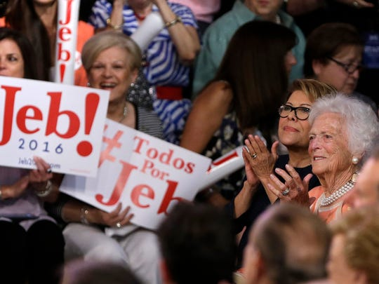 Jeb Bush's mother, Barbara Bush, right, sits with his wife, Columba Bush, second from right, before the former Florida governor announced his bid for the Republican presidential nomination on June 15, 2015, at Miami Dade College.