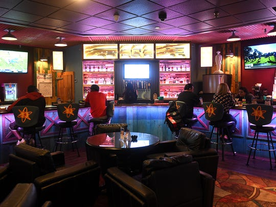 Patrons are seen at the bar at the Atomic Bootlegger Lounge in Sierra Sid's Casino and Truck Stop in Sparks on Oct. 23, 2015.