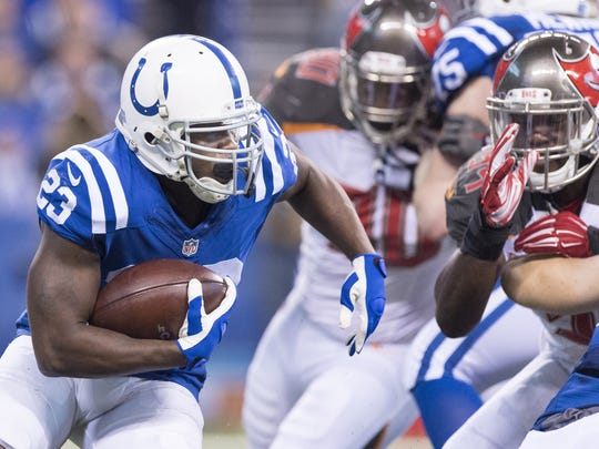 Indianapolis Colts running back Frank Gore (23) rushes the ball into the Tampa Bay Buccaneers defense during the first half of an NFL football game Sunday, Nov. 29, 2015, at Lucas Oil Stadium.