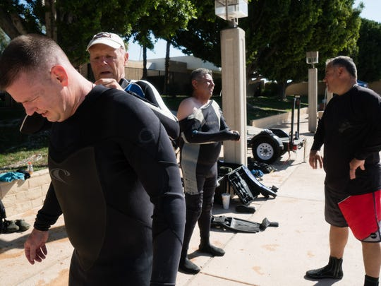 Divers from a Coachella Valley diving team zip into