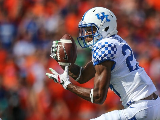 Kentucky cornerback Derrick Baity (29) intercepts a pass thrown by Florida quarterback Luke Del Rio (14) during first half NCAA college football action in Gainesville, Fla., Saturday, Sept. 10, 2016. (Gary McCullough/The Florida Times-Union via AP)