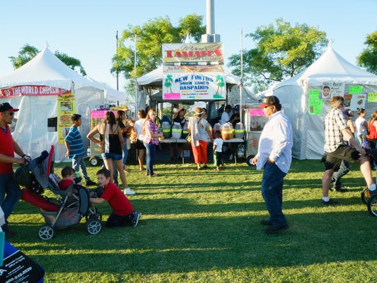 Crowds line up for various food vendors at the El Grito