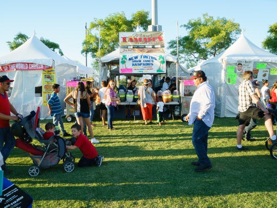 Crowds line up for various food vendors at the El Grito celebration in Coachella, Sunday, Sept. 18, 2016.