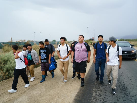 Students from Desert Mirage High School walk off campus and six miles to the CVUSD offices to show  support for teachers who are in stalled negotiations with district officials, Sept. 20, 2016.