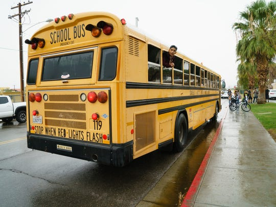 School buses bring students back to school from the