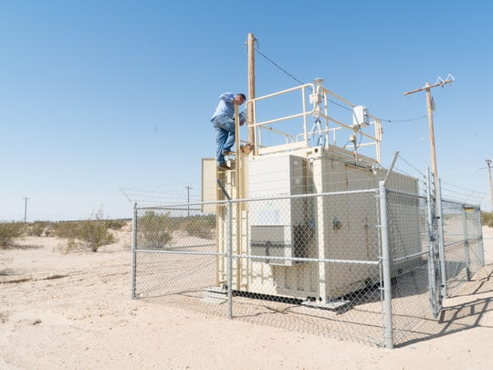 Humberto Lugo, of Comite Civico, installs an air monitor at a site on the west side of the Salton Sea, Sept. 6, 2016.