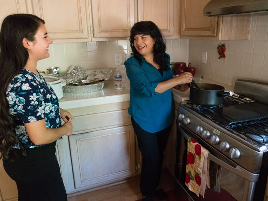 Jessica Herrera and her mother Maria Luisa Gomez both feel that new air monitors will help Jessica, who suffers from asthma, manage her symptoms, which can be triggered by air pollution, Sept. 12, 2016.