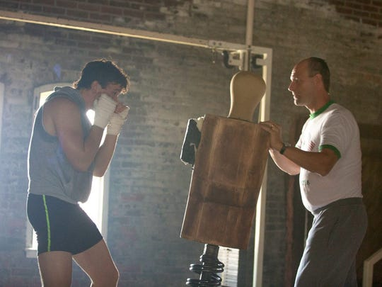 """Miles Teller plays boxer Vinny Pazienza and  Aaron Eckhart is his trainer in """"Bleed for This."""""""
