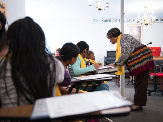 Pastor Martha Evans works with students in an after