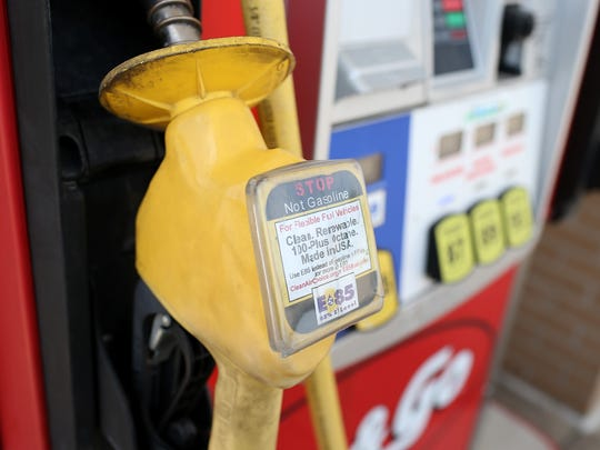 A warning label is posted on an E85 Ethanol pump handle at a Kum & Go gas station on August 7, 2012 in Johnston.