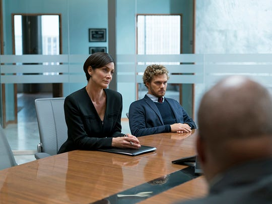 "Carrie-Anne Moss returns as Jeri Hogarth (left), to star with Finn Jones in ""Iron Fist."""