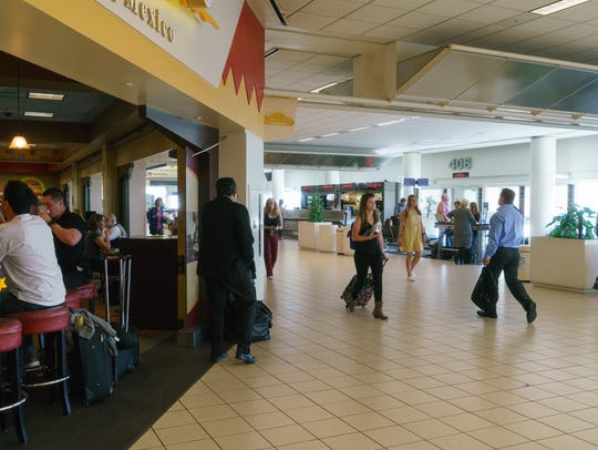Passengers fill up a restuarant in Terminal 4 of Ontario