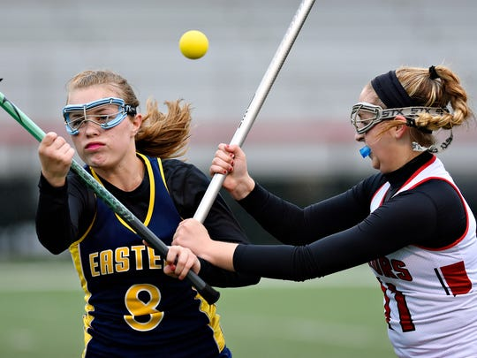Susquehannock's Emma Stiffler, right, and Eastern's Alexus Rexrath struggle to control a lose ball during lacrosse action at Susquehannock High School in Shrewsbury Township, Tuesday, April 25, 2017. Susquehannock would win the game 23-8. Dawn J. Sagert photo