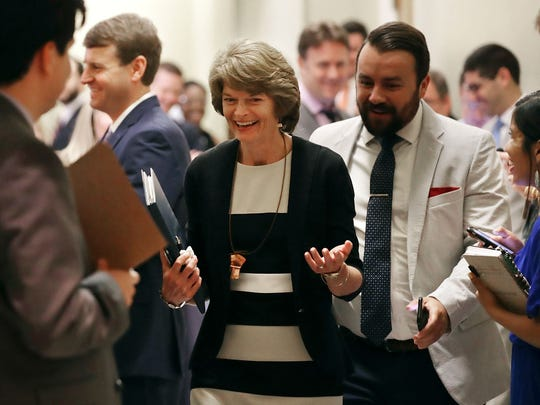 Sen. Lisa Murkowski leaves a meeting with GOP senators