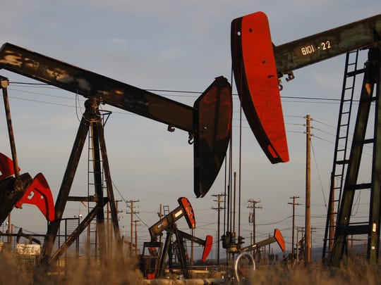 Pump jacks and wells are seen in an oil field on the Monterey Shale formation where gas and oil extraction using hydraulic fracturing, or fracking, is on the verge of a boom.