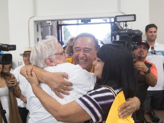 At center, Mario Lazcano, immigrant rights activist,