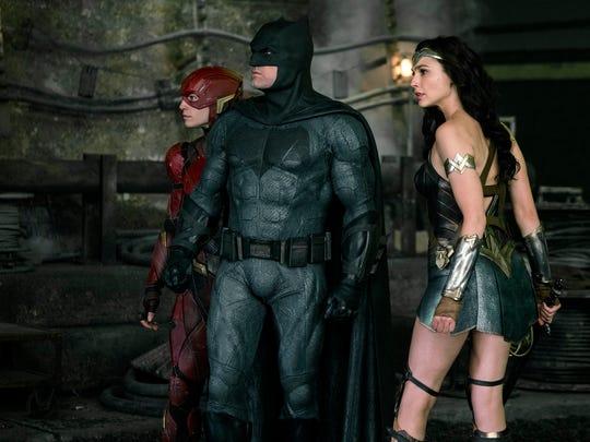 The Flash (far left, Ezra Miller) joins superheroes Batman (Ben Affleck) and Wonder Woman (Gal Gadot) in 'Justice League.'