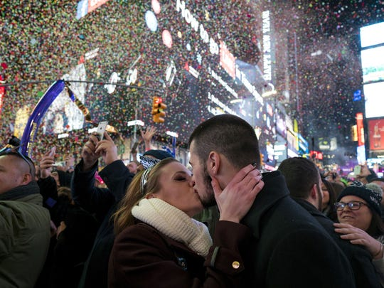 Craig Ruttle,  AP Kaitlin Olivi of Yonkers, N.Y., and Lucas Pereira, of Sayreville, N.J., kiss as confetti falls in New York?s Times Square. Kaitlin Olivi of Yonkers, N.Y., and Lucas Pereira, of Sayreville, N.J., kiss as confetti falls during a celebration of the new year in New York's Times Square, Sunday, Jan. 1, 2017. (AP Photo/Craig Ruttle) ORG XMIT: NYCR112