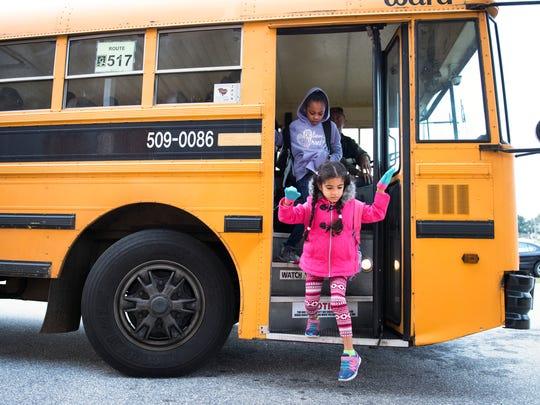 First-grader Sophie Hernandez gets off the bus at Fork Shoals Elementary School on Nov. 14, 2017.