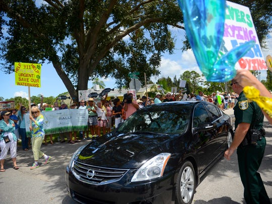 Approximately 500 protesters lined the entrance to the St. Lucie Lock and Dam as the cars containing Gov. Rick Scott and his entourage as they arrived Aug. 20, 2013, to tour the locks and view the releases from Lake Okeechobee.