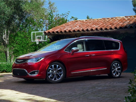 Webb Bland/AP  2017 Chrysler Pacifica easy entry and