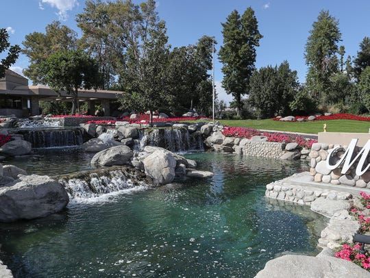 A water feature flows outside of the Club at Morningside in Rancho Mirage. California officials are considering conservation regulations that would require fountains to recirculate water – a requirement that many fountains already meet.