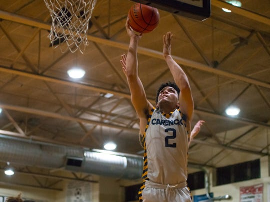 Carencro's Braylon Chaisson finds himself wide open inside for a bucket during the Golden Bears' 55-40 regional win over Salmen on Tuesday.