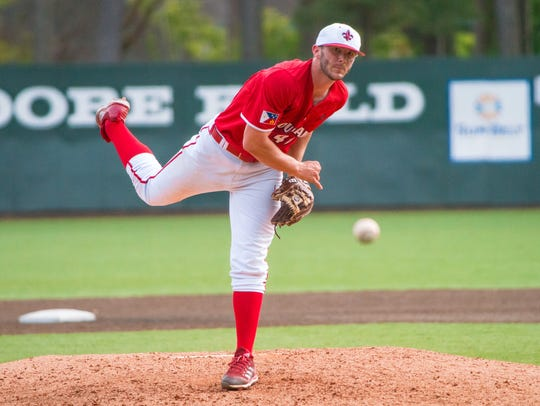 UL's Dylan Moore throws a pitch to the batter as the