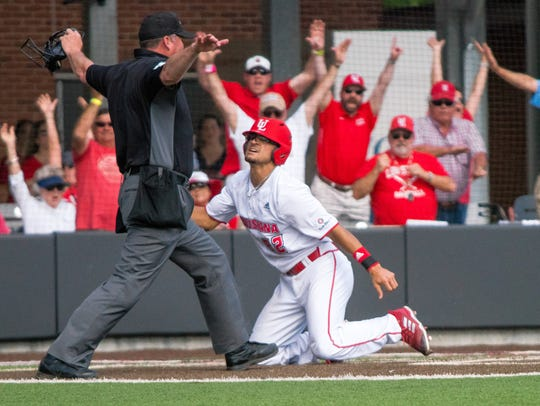 UL pinch-runner Marco Ramos is ruled safe at the plate on Zach LaFleur's game-winning RBI single to right in Sunday's 4-3 win over Troy at Tigue Moore Field at Russo Park.