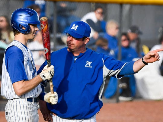 Memorial head coach Matt Collins gives some hitting advice to Memorial's Max Spradlin (15) as the Memorial Tigers play the Reitz Panthers in a SIAC match-up at Memorial's NJ Stone Field Friday, April 20, 2018.