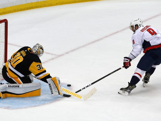Pittsburgh Penguins goaltender Matt Murray (30) stops a shot by Washington Capitals' Alex Ovechkin (8) during the first period in Game 3 of an NHL hockey second-round playoff series in Pittsburgh, Tuesday, May 1, 2018. (AP Photo/Gene J. Puskar)