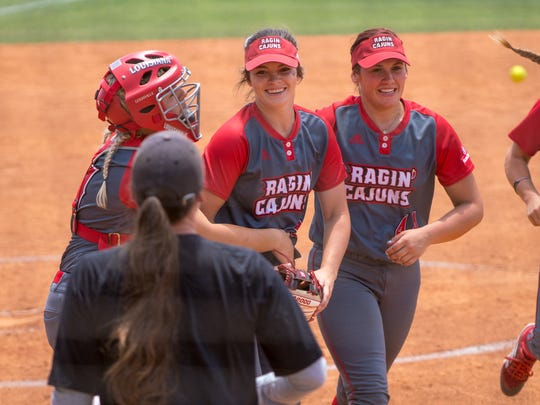 UL's Summer Ellyson (center) celebrates with teammates after her no-hitter in a 1-0 Sun Belt Conference Tournament win over Texas State on Friday at Lamson Park.