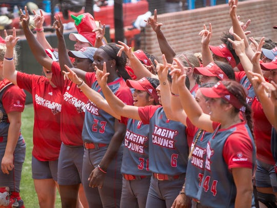 The UL softball team celebrates their win with the
