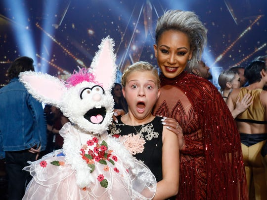 Darci Lynne Farmer, left, seen with judge Mel B, won