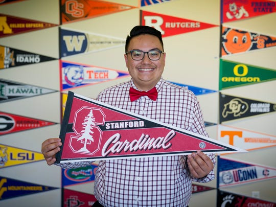 Luis Jimenez, 17, poses for a portrait with a Stanford