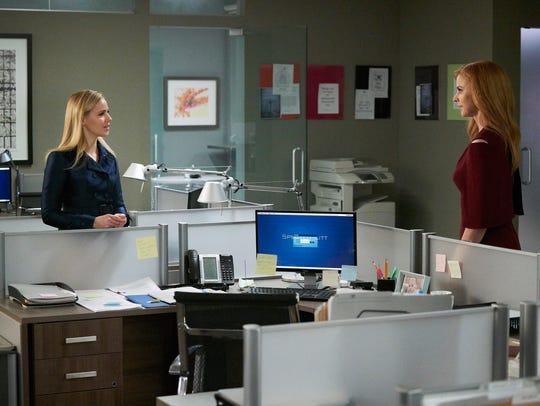 Amanda Schull as Katrina Bennett and Sarah Rafferty
