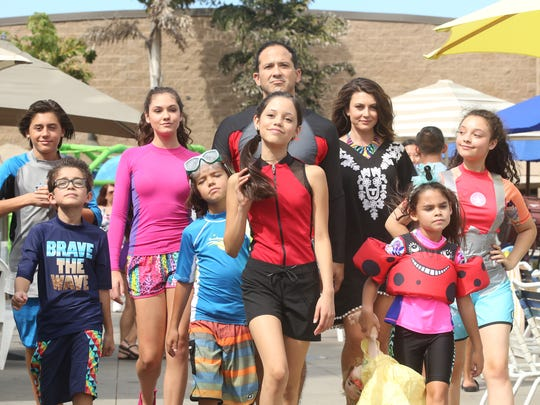 """Stuck in the Waterpark - The Movie"" - The Diaz family jumps in, slides down and wades right into the metaphorical deep end of a family vacation when Harley's winning invention scores the family a free trip to a waterpark, in the season two premiere of ""Stuck in the Middle."" Jenna Ortega is in the middle wearing red and black."