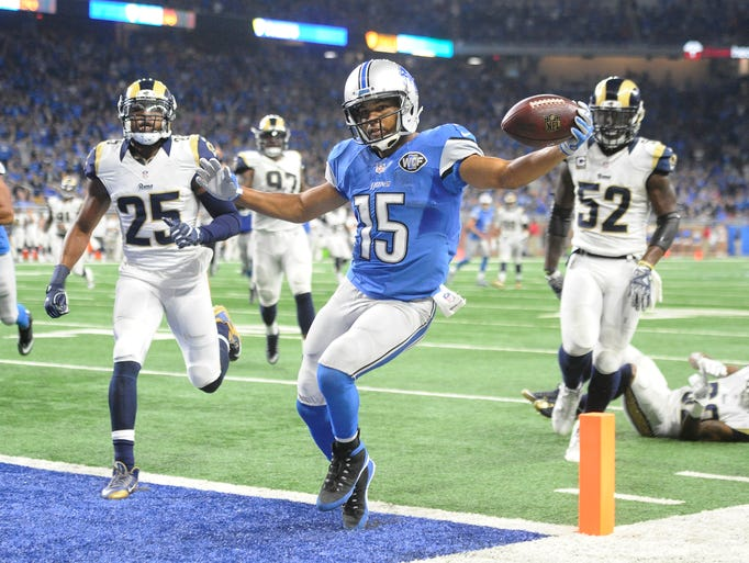 Lions wide receiver Golden Tate tip-toes into the end