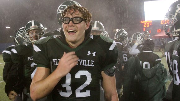 Pleasantville's Nick Zalzarulo (32) celebrates with his teammates after defeating Glens Falls 20-7 in the state Class B semifinal at Middletown High School Nov. 18, 2017.