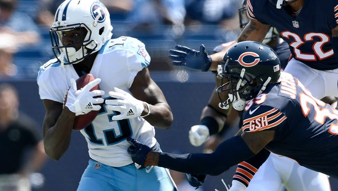 Titans wide receiver Taywan Taylor (13) gets away from Bears defensive back Eddie Jackson (39) in the second quarter at Nissan Stadium Sunday, Aug. 27, 2017 in Nashville, Tenn.
