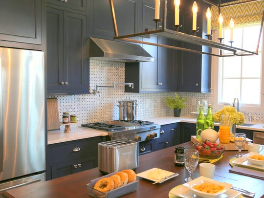 Have you ever thought of installing a backsplash in the kitchen that might be found on a bathroom floor? That's exactly what they did in the kitchen of the HGTV Smart Home.