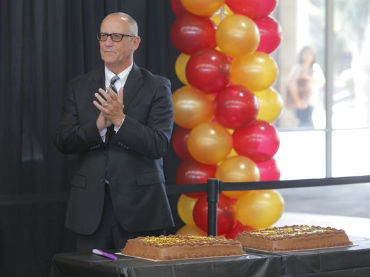 "Hartnell College president Willard Lewallen thanks faculty, student and guests after they sang him ""Happy Birthday"" Thursday during his 60th birthday celebration at the collegeÕs Student Center."