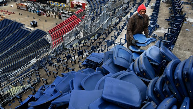 Randy Beaty works to remove old seats to be replaced in the upper deck of Nissan Stadium on Feb. 12, 2016. The seat replacement project will cost $15 million.