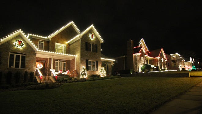 Outdoor Lighting Pros decorated these homes in Hurstbourne Park in Franklin, offering the holiday spirit in spades to residents and visitors alike.