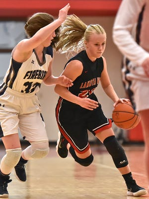 Lakota West's Ally Haar drives past a Kettering defender Saturday, March 3rd at Princeton High School