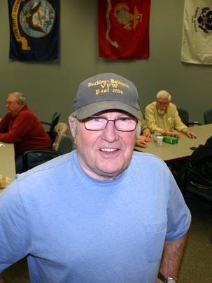 Bill Haack stands among veterans during the American