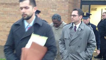 Andrew Simmons, center, leaving Penfield Town Court on Nov. 7.