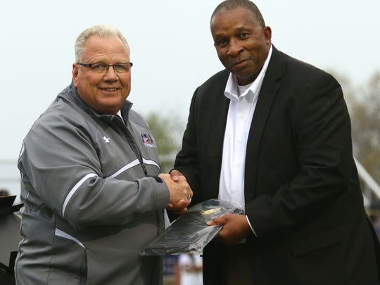Stan Jefferson, a former Ashland University and Mansfield Senior football coach now part of the Ohio State football program, receives a Lifetime Achievement Award from AU Gridiron Club president Don Graham. The ceremony took place prior to Ashland's spring football game Thursday night.